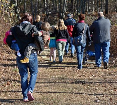 Photo of Families walking down a hiking trail